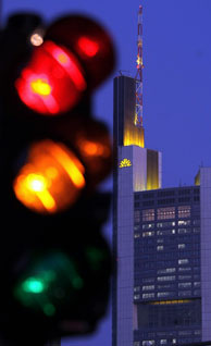 File photo: The headquarters of Germany's Commerzbank AG stands illumilated behind a traffic light on January 9, 2009 in Frankfurt am Main, Germany