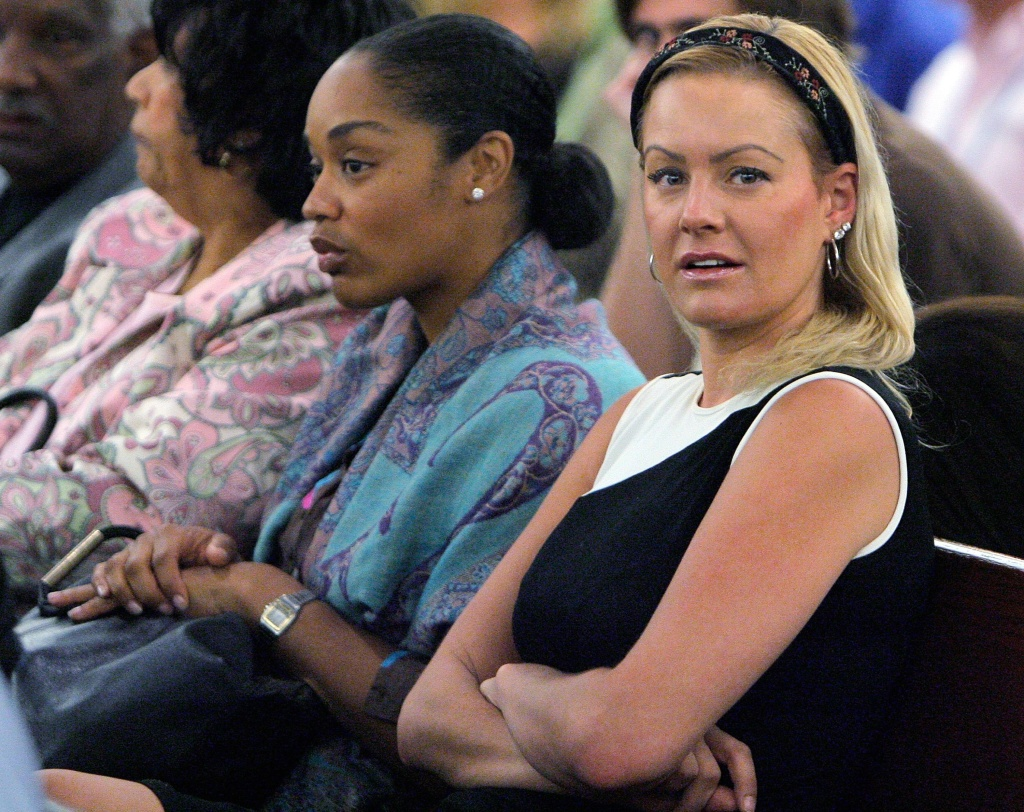 O.J. Simpson's daughter Arnelle Simpson (C) and Simpson's girlfriend Christine Prody (R) attend O.J. Simpson's court appearence  on charges which include kidnapping, assault and burglary at the Clark County Regional Justice Center September 19, 2007 in Las Vegas, Nevada.