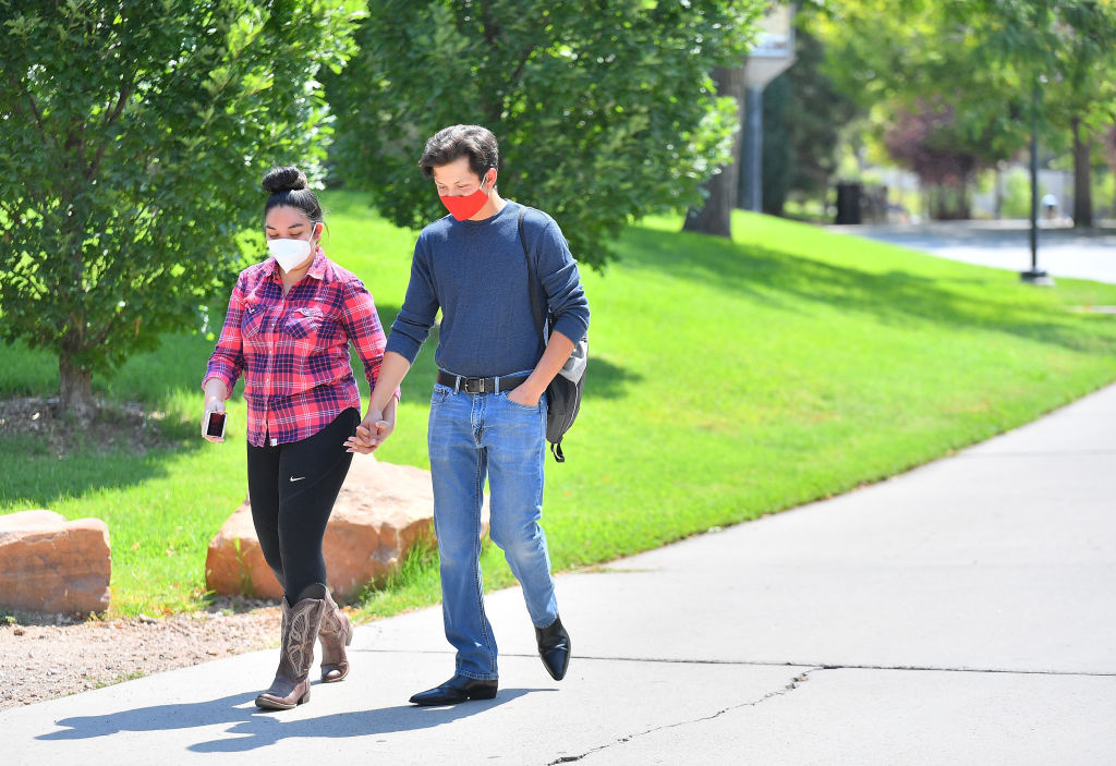 Victoria Suazo and Jesus Retano walk to class as students begin classes amid the coronavirus (COVID-19) pandemic on the first day of the fall 2020 semester at the University of New Mexico on August 17, 2020 in Albuquerque, New Mexico.