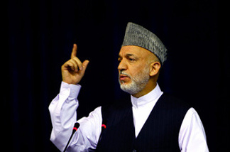 President Hamid Karzai is under pressure from the Obama administration to crack down on government corruption. U.S. officials say the Afghan public perception that government is corrupt could be boosting the Taliban's popularity.