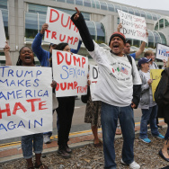 Manny Aguilar leads a group of anti-Trump protestors in a chant against the candidate, Friday, May 27, 2016, in San Diego. Trump is scheduled to speak in San Diego Friday afternoon. (AP Photo/Lenny Ignelzi)