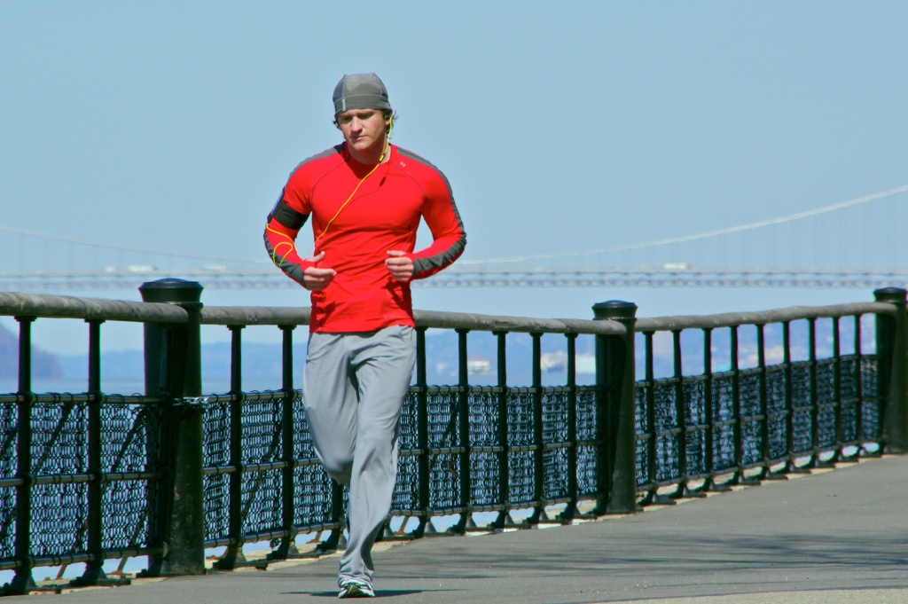 A runner uses an ipod during an excercise in Arsonia, New York on Jan. 17, 2012.