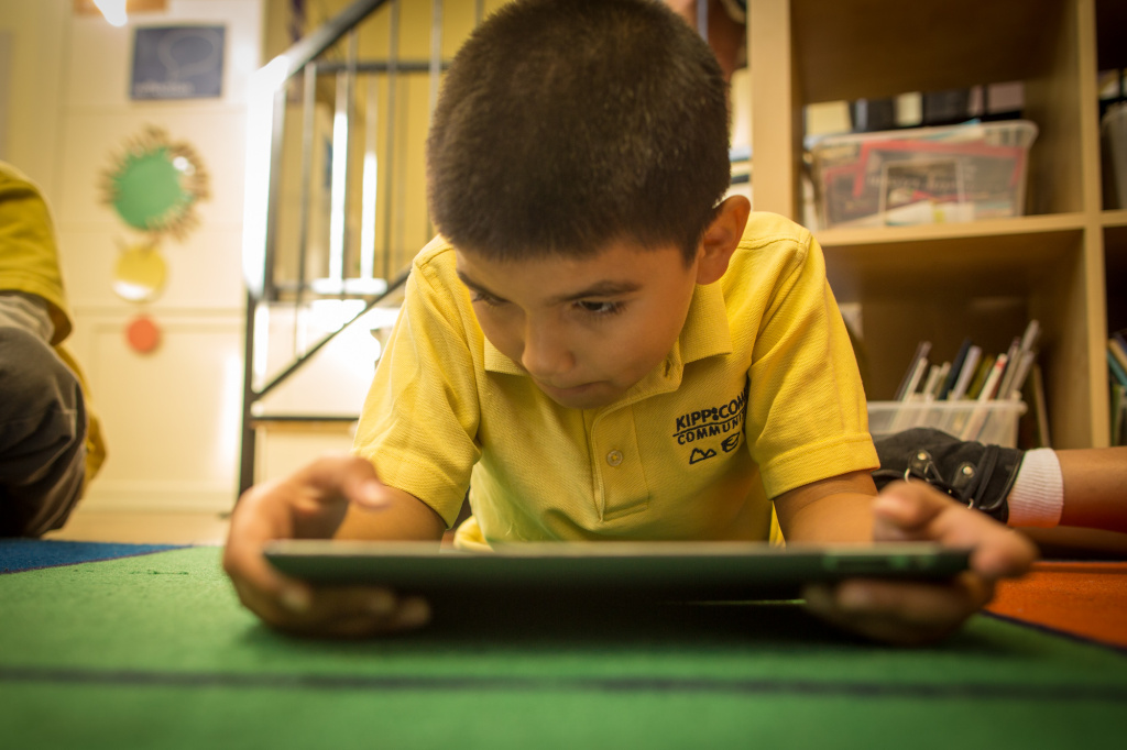 Second grader Ramiro V. plays a math game on an iPads at Komienza Community Prep in Huntington Park.