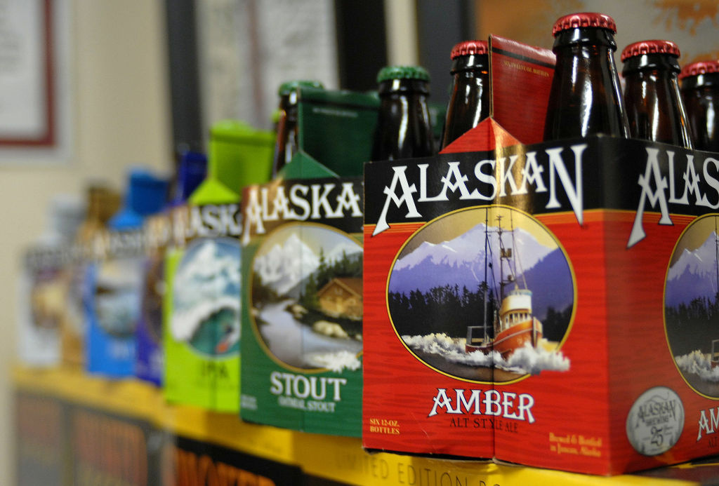 In this photo taken Jan 23, 2013, in Juneau, Alaska, are six-packs of beer displayed at the Alaskan Brewing Co. The brewery has installed a unique boiler system that burns the company's spent grain the accumulated waste from the brewing process into steam which powers the majority of the plant's operations.