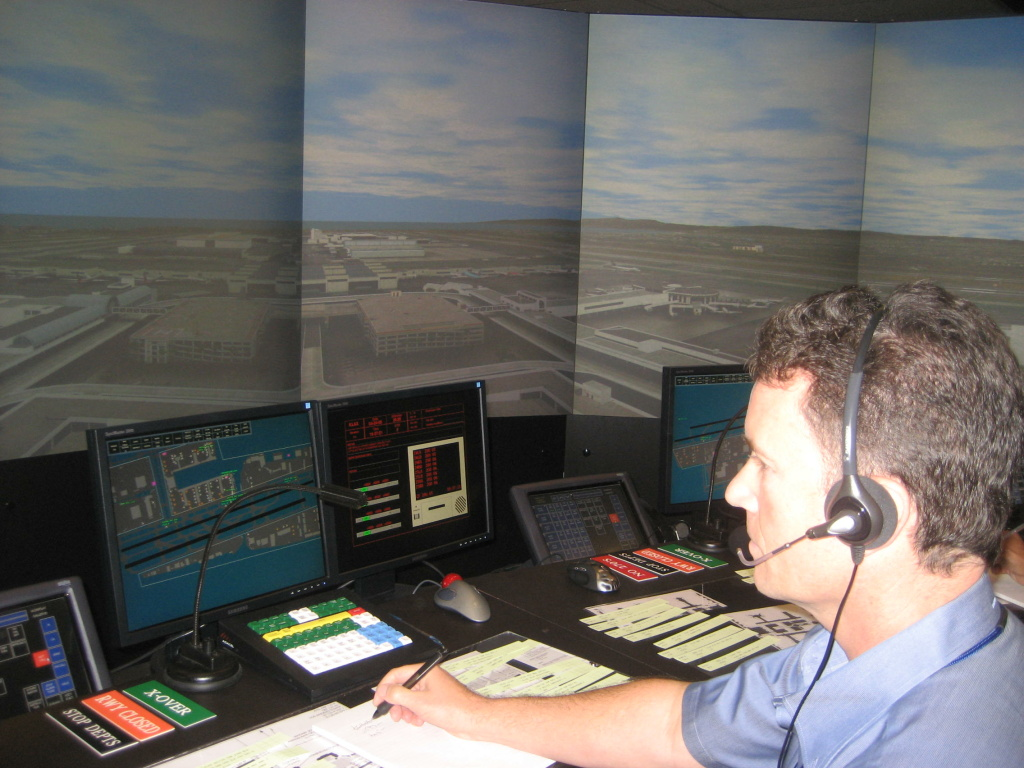 Retired air traffic controller Mark Pawlowski demonstrates the LAX tower simulator.