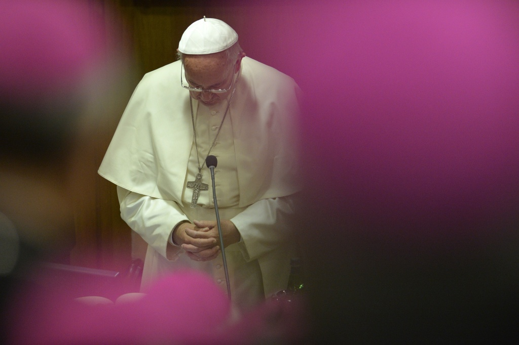Pope Francis prays during the 68th General Assembly of the Italian Episcopal Conference on May 18, 2015 at the Vatican.   AFP PHOTO / ANDREAS SOLARO        (Photo credit should read ANDREAS SOLARO/AFP/Getty Images)
