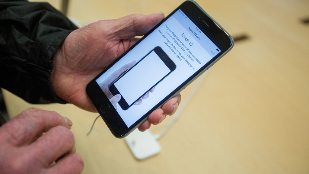 Apple says that it slows the processors in some of its older phones to match their aging, less powerful batteries. Here, the iPhone 6s Plus is seen at an Apple Store in late 2015.