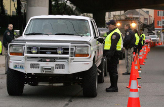 San Francisco police officers check drivers at a sobriety checkpoint.