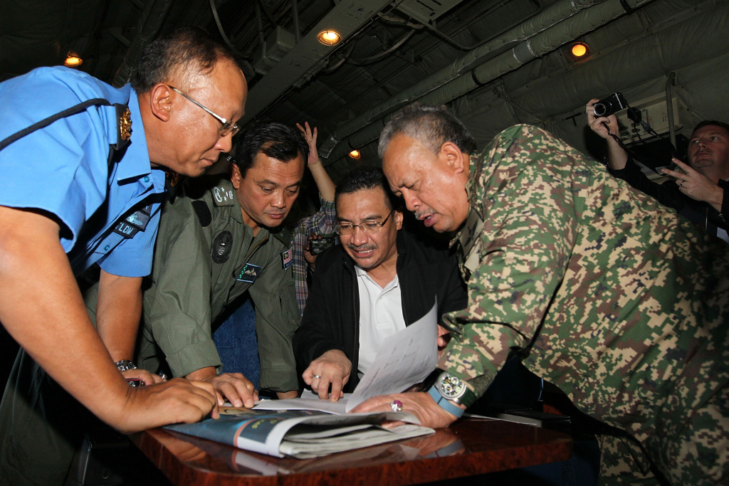 In this handout provided by the Angkatan Tentera Malaysia, Malaysian Royal Navy (TLDM) commander Tan Sri Abdul Aziz Jaafar (left), Lieutenant General Dato' Sri Ackbal bin Hj Abdul Samad (2nd left), Malaysian Defence Minister, Minister of Defence & (Acting) Minister of Transport  Dato' Seri Hishammuddin Hussein (2nd right), and Malaysian Defence Forces chief Tan Sri Zulkifeli Mohd Zin discuss their strategy during a search and rescue mission flight on March 11, 2014 in Kuala Lumpur, Malaysia.