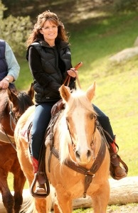 Sarah Palin trots along a trail with her horse companion.