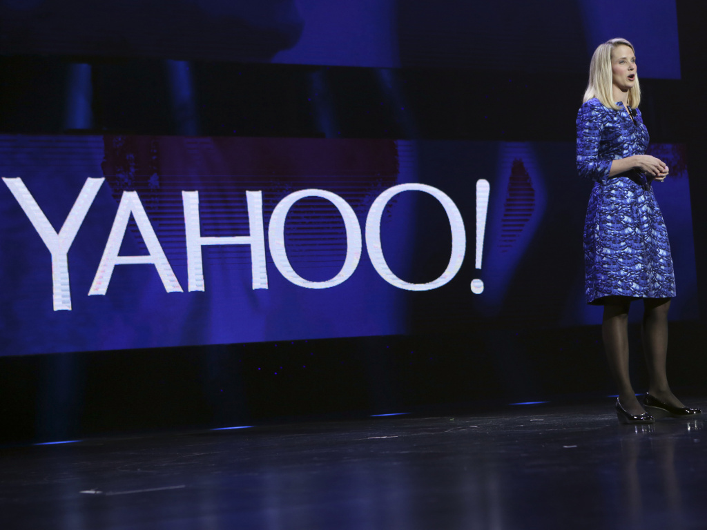In this file photo, Yahoo CEO Marissa Mayer delivers the keynote address at the annual Consumer Electronics Show (CES) in Las Vegas, Nevada in January 2014. Yahoo announced Tuesday, January 27, 2015, that was spinning off the company's prized stake in China's Alibaba Group Holding in a move that will let Yahoo avoid paying billions in future taxes.