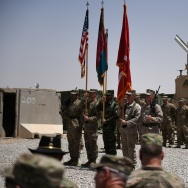 US Marines and Afghan National Army (ANA) personnel hold flags during a handover ceremony at Leatherneck Camp in Lashkar Gah in the Afghan province of Helmand on April 29, 2017.