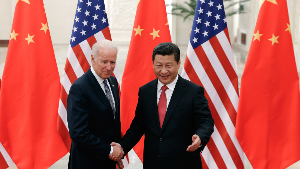 Then-Vice President Joe Biden shakes hands with Chinese President Xi Jinping in Beijing on Dec. 4, 2013.