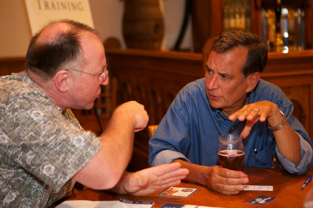 Sam Adams brewer and Boston Beer Company founder Jim Koch, right, speed coaches a small businessperson at an event in Los Angeles.
