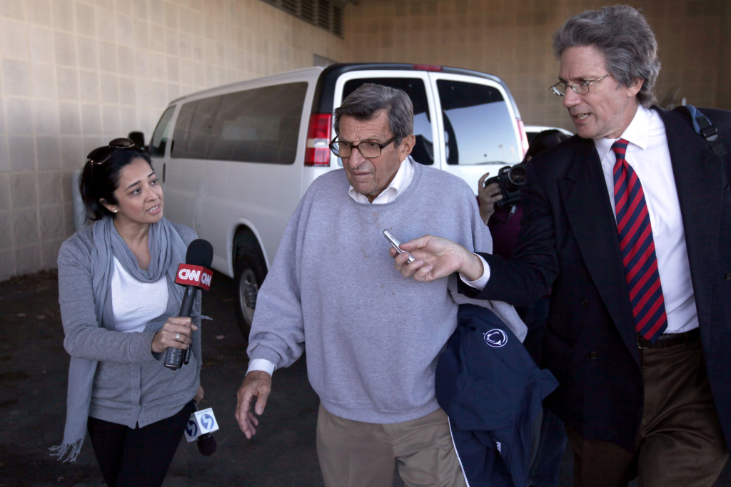 Penn State University head football coach Joe Paterno is surrounded by the media while leaving the team's football building on November 8, 2011 in University Park, Pennsylvania.