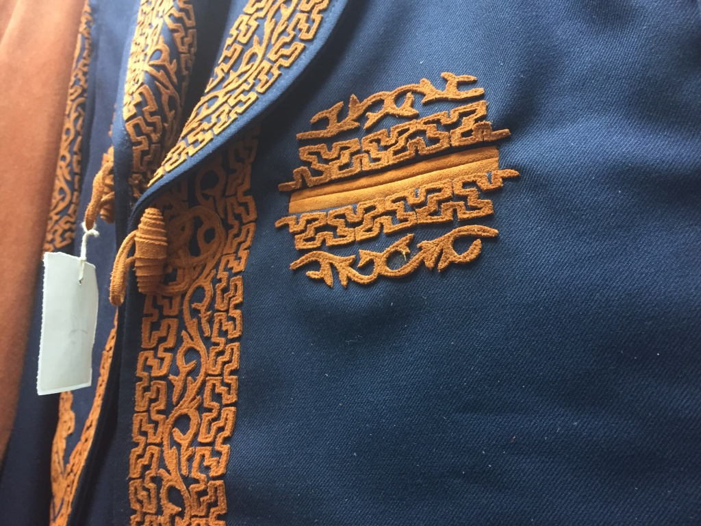 Close-up on intricate Greek pattern on a Charro blazer.