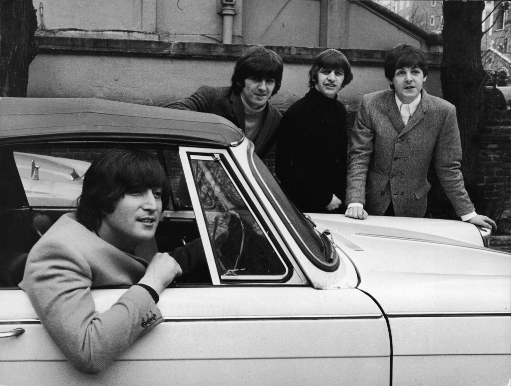 John Lennon (1940 - 1980), of the British pop group the Beatles, sits in his car after passing his driving test, February 16, 1965. Bandmates, from left, George Harrison (1943 - 2001), Ringo Starr, and Paul McCartney, show their support. The president's authority to defer deportation goes back to the immigration proceedings over John Lennon in the 1970s.