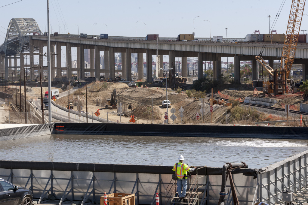 Foundation work begins on 350 foundation piles constructed in the ground at depths down to 175 feet below the surface for the new Gerald Desmond Bridge Replacement Project in the Port of Long Beach in Long Beach, Calif., Wednesday, Oct. 1, 2014. The Gerald Desmond Bridge will be one of the tallest bridges of its kind in the United States. With two 515-foot towers and a cable-stayed design. During the pile construction, crews maintain even pressure of holes to ensure there is no upward movement of groundwater from the deeper layers of multiple aquifers. (AP Photo/Damian Dovarganes)