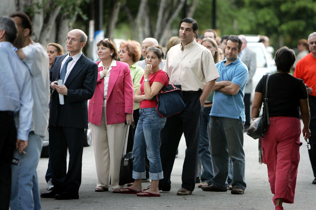 Miami voters wait in a long line to cast their ballots early for the President of the United States October 27, 2004. There are reports of people waiting up to three hours to vote in the South Florida area