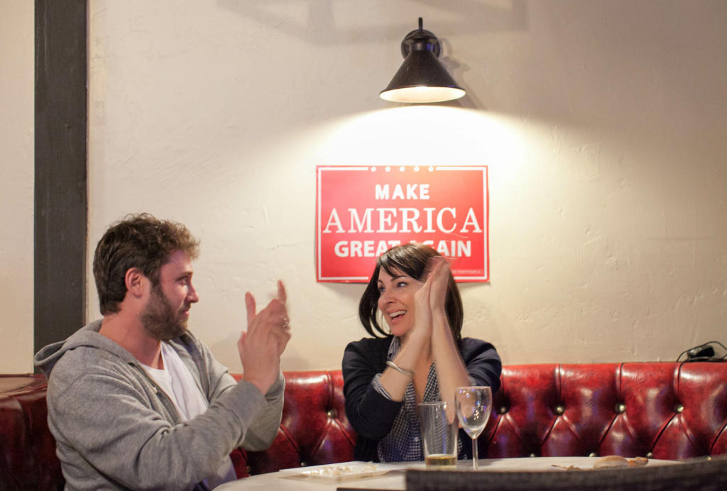 Adam White and his wife, Stephanie Wheeler-White, react during the second presidential debate at JJ's Bar & Grill in Santa Clarita, Calif. on Sunday, Oct. 9, 2016.