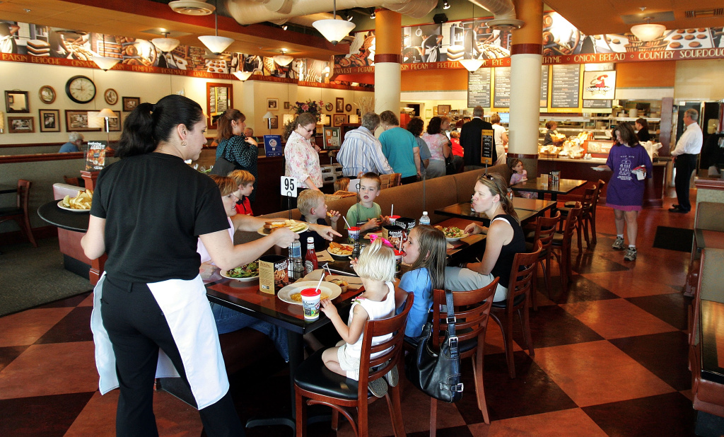 A server delivers food to customers at a Corner Bakery Cafe October 4, 2005 in Glenview, Illinois.