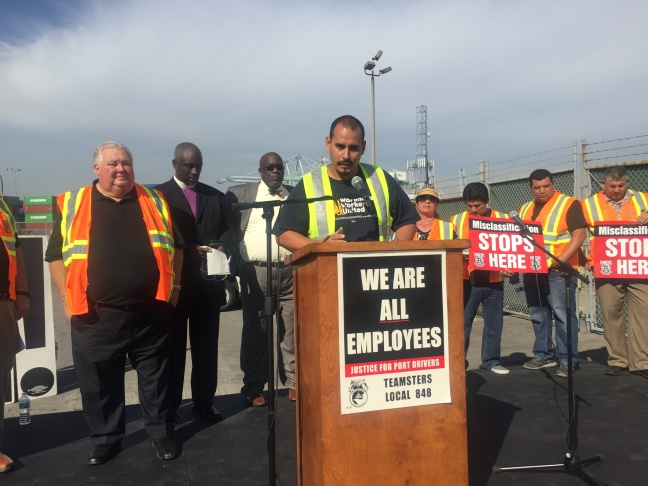 Anthony Vallecillo says he has worked in the warehouse at California Cartage for nearly three years, and is still a temp.