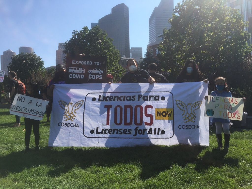 Immigrant rights activists rally for drivers licenses in Boston.