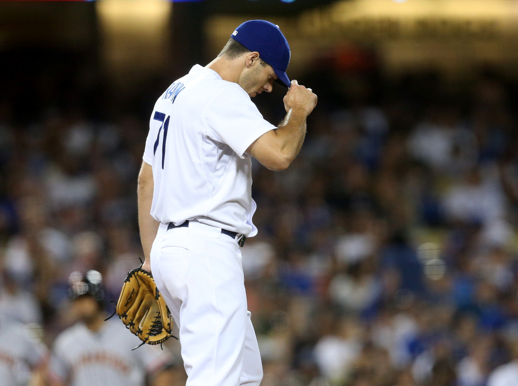 File: Relief pitcher Josh Ravin #71 of the Los Angeles Dodgers reacts after walking in a run in the seventh inning against the San Francisco Giants at Dodger Stadium on June 19, 2015 in Los Angeles.