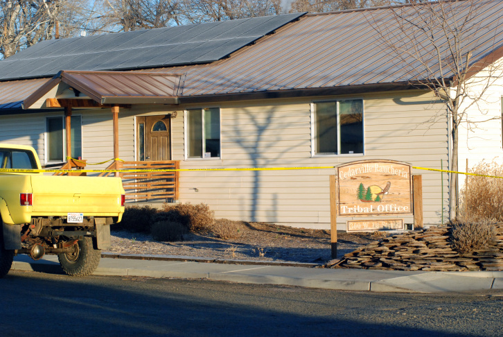 Crime scene tape surrounds the tribal headquarters of the Cedarville Rancheria Friday, Feb. 21, 2014 in Alturas, Calif., where police say an eviction hearing turned deadly as a woman who once served as a tribal leader allegedly opened fire, killing four people and critically wounding two others in a gun and knife attack. Cherie Lash Rhoades, a former chairwoman of Cedarville Rancheria, was taken into custody after the bloody attack at the tribal office Thursday afternoon, Alturas police chief Ken Barnes said in area media reports.