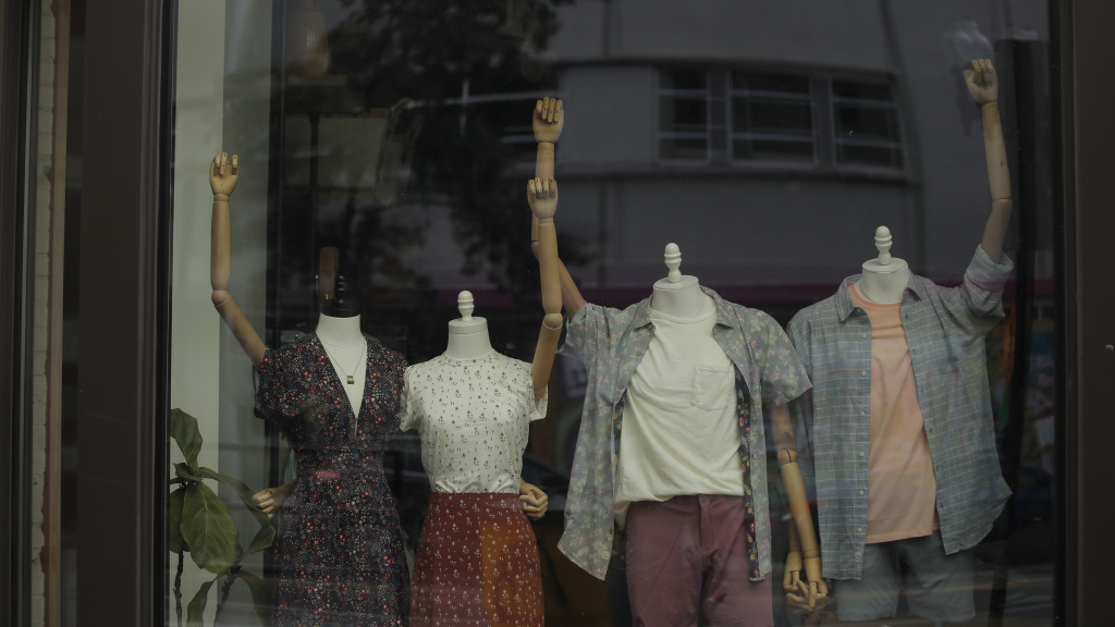 Mannequins in a clothing shop are posed to show solidarity with the Black Lives Matter movement in Washington, D.C., on June 19, 2020. The city was marking Juneteenth, the holiday celebrating the day in 1865 that enslaved Black people in Galveston, Texas, learned they had been freed from bondage, more than two years after the Emancipation Proclamation. Juneteenth is now a federal holiday.