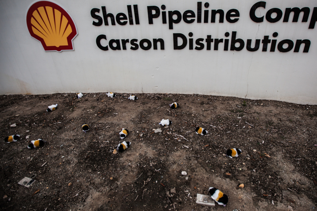 In March, protesters tossed toy guinea pigs at a sign for the Shell Pipeline Company outside their facility in Carson.