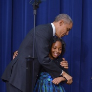 President Obama hugs Alajah Lane, 9, after she introduced him at Wednesday's White House Summit on Early Childhood Education.