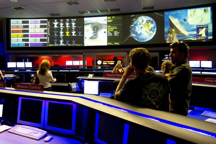 Bobak Ferdowsi shows KPCCers a mock Curiosity at JPL.