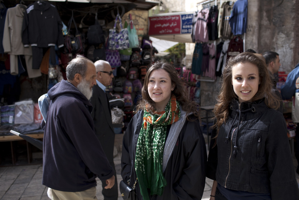 American students Tal Eisenzweig (R) and Kelly Roache from New Jersey tour the old city of Jerusalem on February 16, 2011.