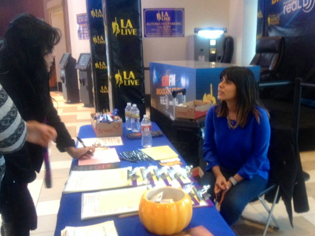 Jacqueline Andrade, a blood donor recruiter at Children's Hospital Los Angeles, tells moviegoers about the blood drive.