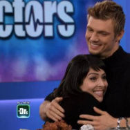 "A screenshot of Backstreet Boys superfan Nadia Vazquez meeting the Backstreet Boys' Nick Carter on ""The Doctors."""