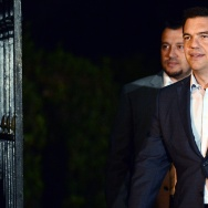 Greek Prime Minister Alexis Tsipras exits the presidential palace in Athens after presenting his resignation on August 20, 2015.