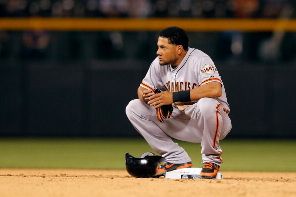 Melky Cabrera of the San Francisco Giants pauses at second base after doubling against the Colorado Rockies at Coors Field on August 3, 2012 in Denver, Colorado.