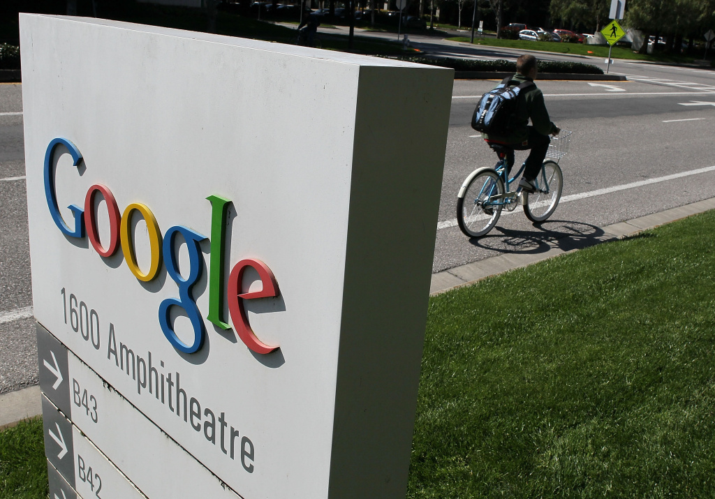 A bicyclist rides by a sign outside of the Google headquarters March 10, 2010 in Mountain View, California. Google announced today that they are adding bicycle routes to their popular Google Maps and is available in 150 U.S. cities.