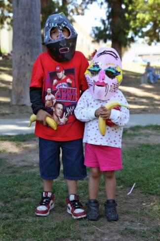 Two kids pose with their decorated face mask at