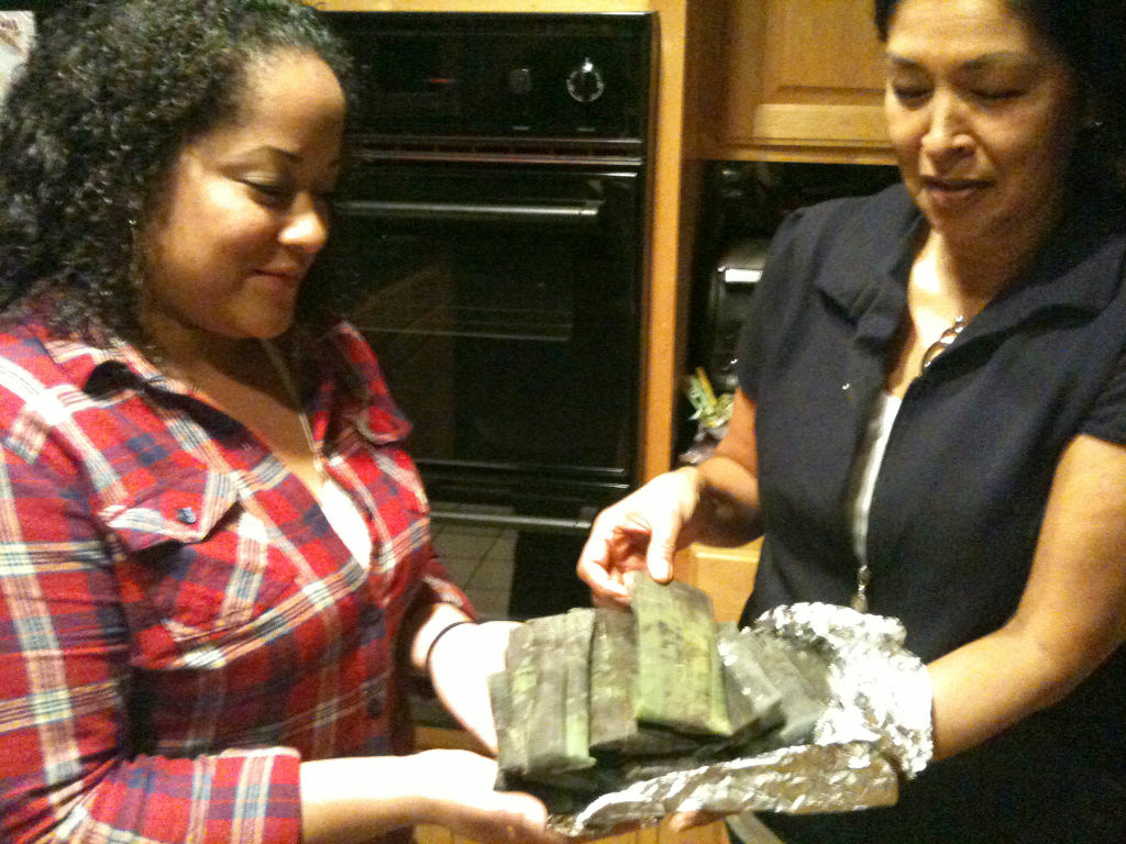 Rosa Alvarez, right, and daughter-in-law Nicole Maiden Alvarez show off the results of a tamale making class that helped them bond in the kitchen.