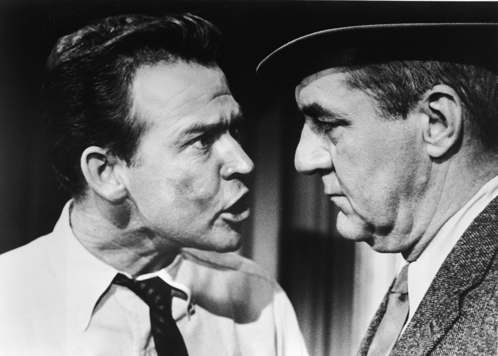 American actor Bobs Watson (1930 - 1999) emphatically shouts in a scene with actor Jim Backus (1913 - 1989) from 'The Jim Backus Show' (also known as 'Hot Off The Wire'), 1960.
