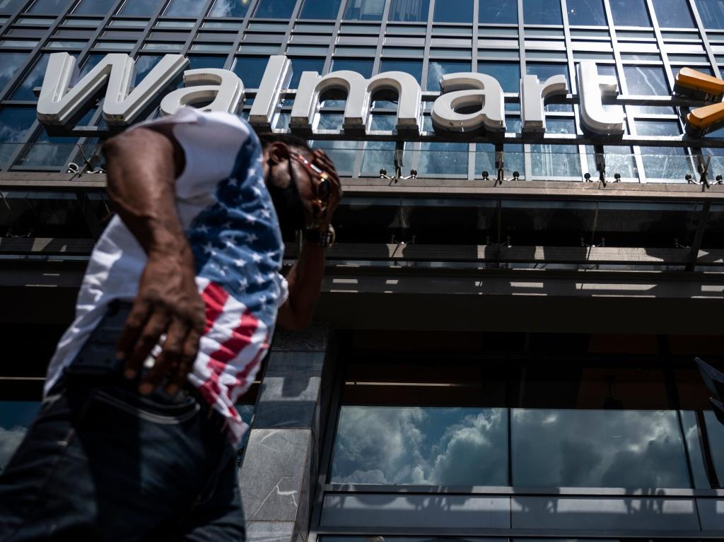 A man walks past a Walmart store in Washington, D.C. on July 15. Walmart said it was