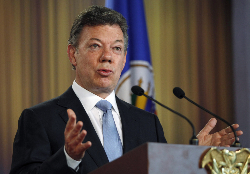 Colombia's President Juan Manuel Santos speaks at a joint press conference with OAS chief Jose Miguel Insulza about a regional study on the illicit drug trade, presented by Insulza to Santos at the Presidential Palace in Bogota, Colombia, Friday, May 17, 2013. The  $2.2 million study which emphasizes drug abuse as primarily a public health issue, makes no firm recommendations, instead suggesting several possible ways to stem the illicit drug trade, which has fueled violent crime and corruption and even destabilized governments.