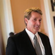 Sen. Jeff Flake (R-AZ) walks to a Senate joint caucus meeting, on Capitol Hill, July 15, 2013 in Washington, DC.