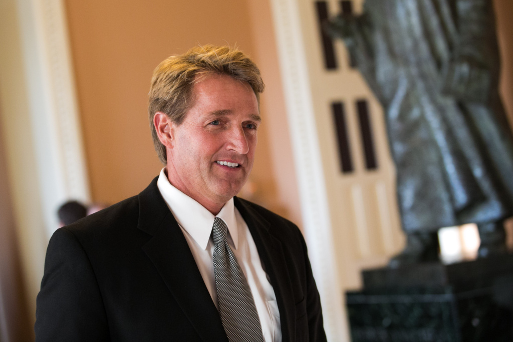File: Sen. Jeff Flake (R-AZ) walks to a Senate joint caucus meeting, on Capitol Hill, July 15, 2013 in Washington, D.C.