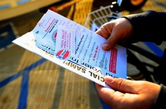 A voter holds a sample ballot after voting for the midterm elections at Los Angeles County Lifeguard headquarters on November 2, 2010 in the Venice neighborhood of Los Angeles, California.