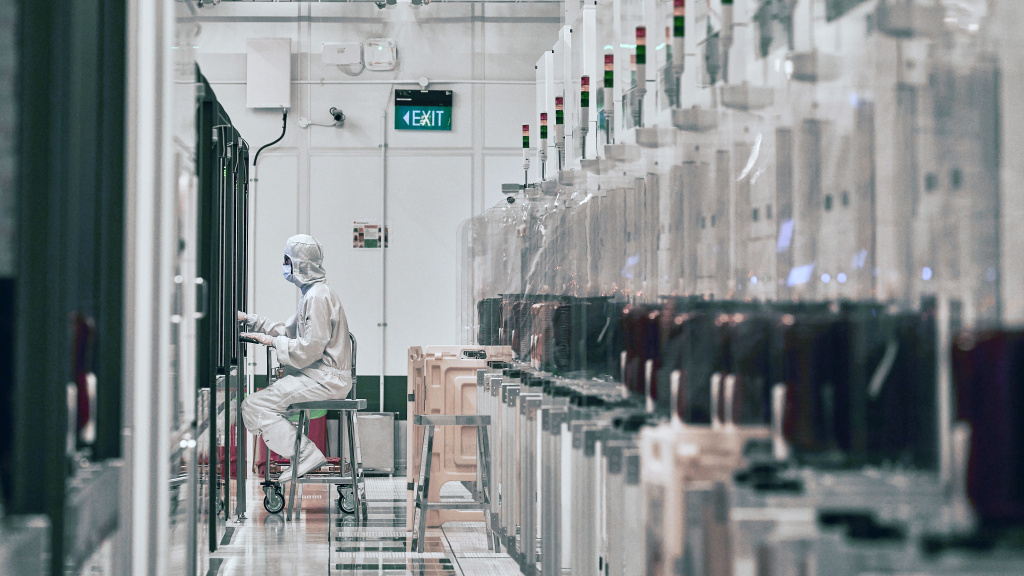 A technician works at a semiconductor fabrication facility in Singapore.