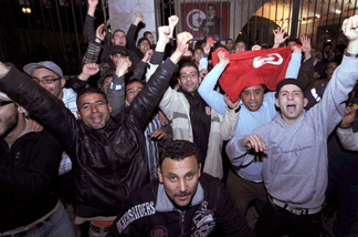 People celebrate in Tunis after Tunisian President Zine El Abidine Ben Ali's address to the nation on January 13, 2011. Ben Ali said he would not seek another term in office and ordered police to stop firing on protesters as he sought to quell mounting unrest.