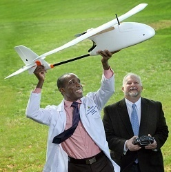 Pathologist Timothy Amukele, left, teamed with Robert Chalmers and other engineers to create a drone courier system that transports blood to diagnostic laboratories.